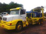 Caminhões Poli-caçambas, utilizados para o transporte de caçambas estacionárias.