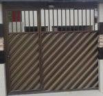 Portão em búzio na diagonal e tubo redondo bronze